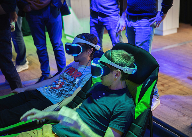 Optifest 2018 Attendees Playing on VR Headset